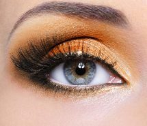 Woman eye with orange make-up